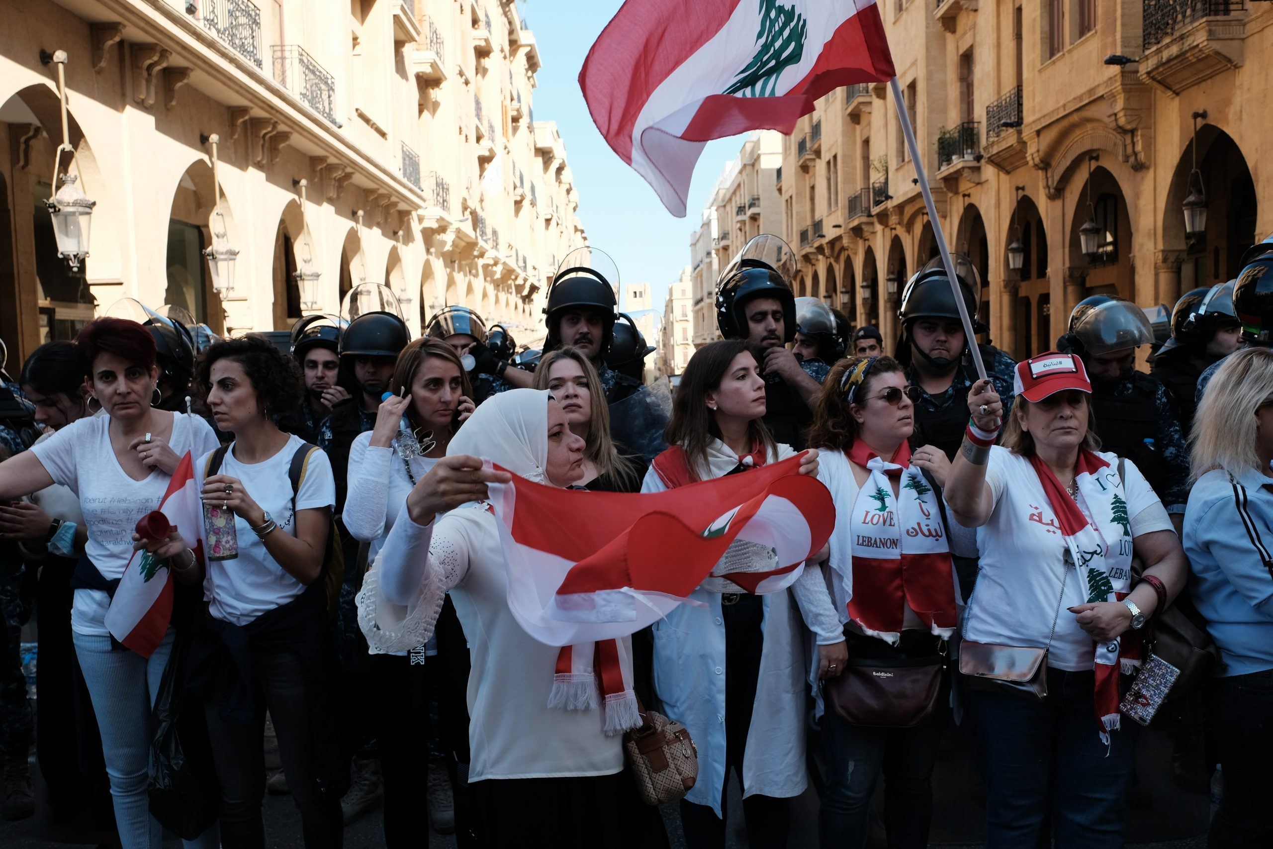 Women protesters forming a line between riot police and protesters in Riad el Solh, Beirut, November 18, 2019 (Wikimedia Commons)
